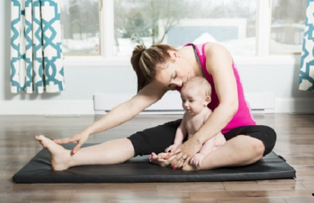 A Mother with child boy doing fitness exercises